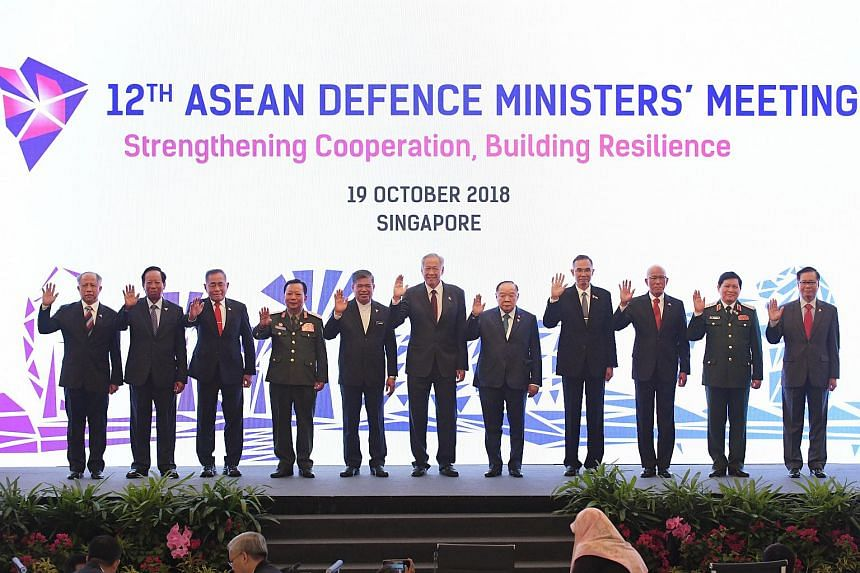 Asean Defence Ministers pose for a group photo at the start of the 12th Asean Defence Ministers' Meeting at the Shangri-la Hotel Singapore, on Oct 19, 2018.