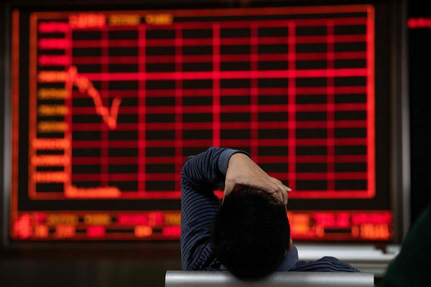 Stocks in Hong Kong and Shanghai tumbled at the open while traders await the release of Chinese growth data.