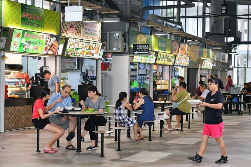 People having meals at Jurong West Hawker Centre on Oct 13, 2018. A dispute about trays at the hawker centre was resolved recently after an August petition by hawkers.