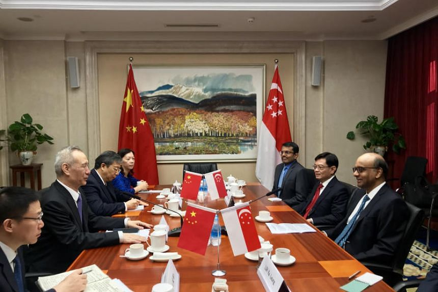 Deputy Prime Minister Tharman Shanmugaratnam (right) meets Chinese Vice-Premier Liu He in Beijing on Oct 18, 2018.