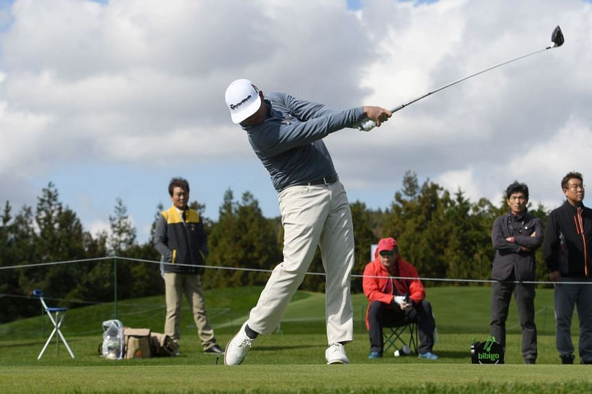 Chez Reavie of the US tees off on the ninth hole during the first round of the CJ Cup golf tournament at Nine Bridges golf club in Jeju Island, on Oct 18, 2018.