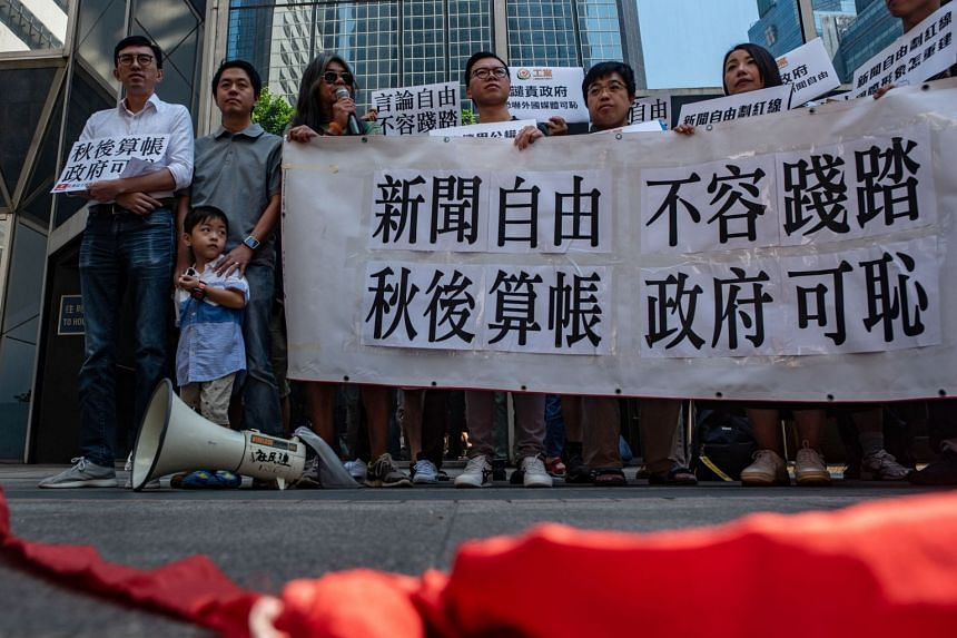 "Demonstrators hold a banner that reads ""freedom of the press, not allowed to be trampled"" in Hong Kong on Oct 6, 2018."