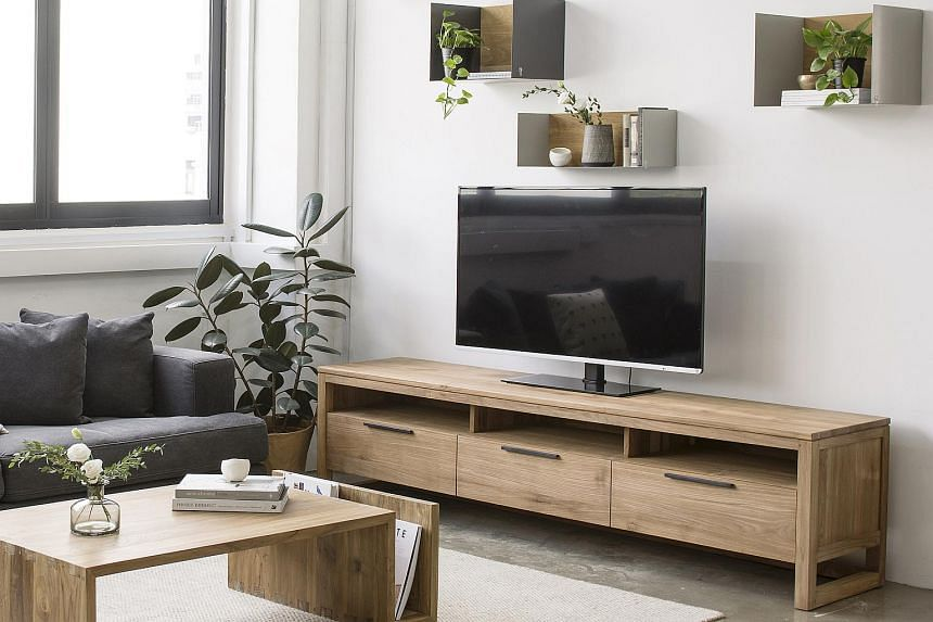 A living room that features a teak coffee table from Ethnicraft Online.