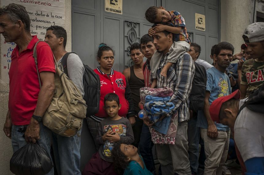 Migrants wait in line for food at Casa Migrante, a makeshift shelter in Guatemala City, on Oct 17, 2018.