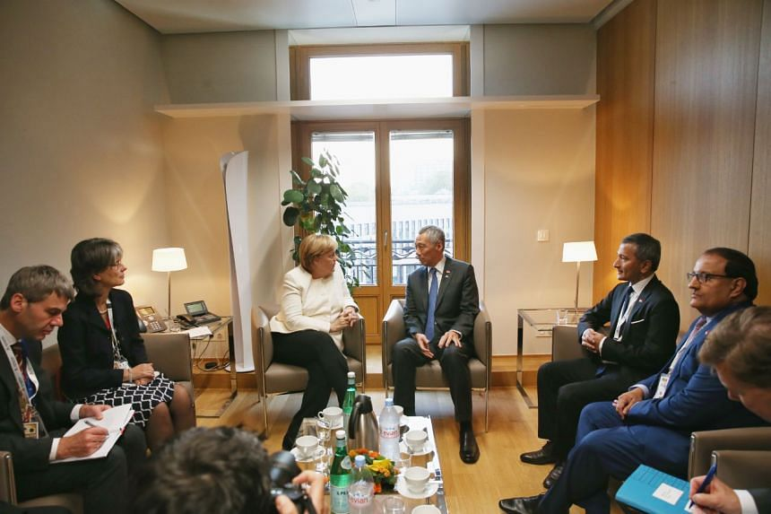 Federal Chancellor Merkel and Prime Minister Lee Hsien Loong during a Singapore-Germany bilateral meeting in Brussels, Belgium before the Asia-Europe Meeting.