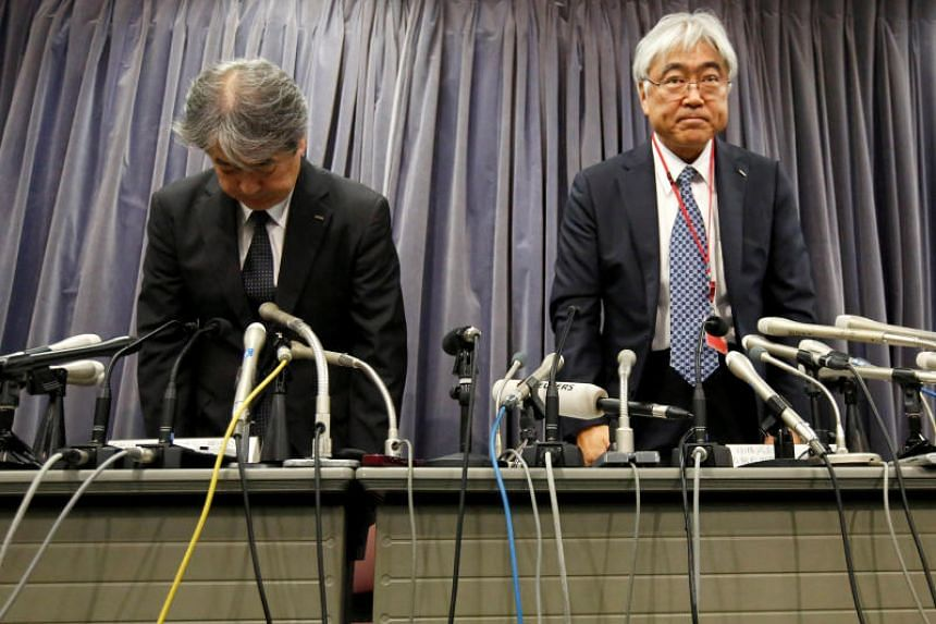 KYB Corp. Senior Managing Executive Officer Keisuke Saito (R) and Kayaba System Machinery Co. President Shigeki Hirokado bow during a news conference at the Land, Infrastructure, Transport and Tourism Ministry in Tokyo, October 19, 2018.