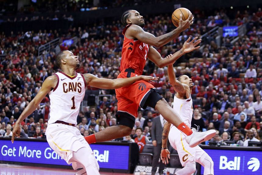 Kawhi Leonard on his way to a lay-up as Rodney Hood (No. 1) and George Hill of the Cleveland Cavaliers fail to stop the Toronto Raptors star at the Scotiabank Arena.