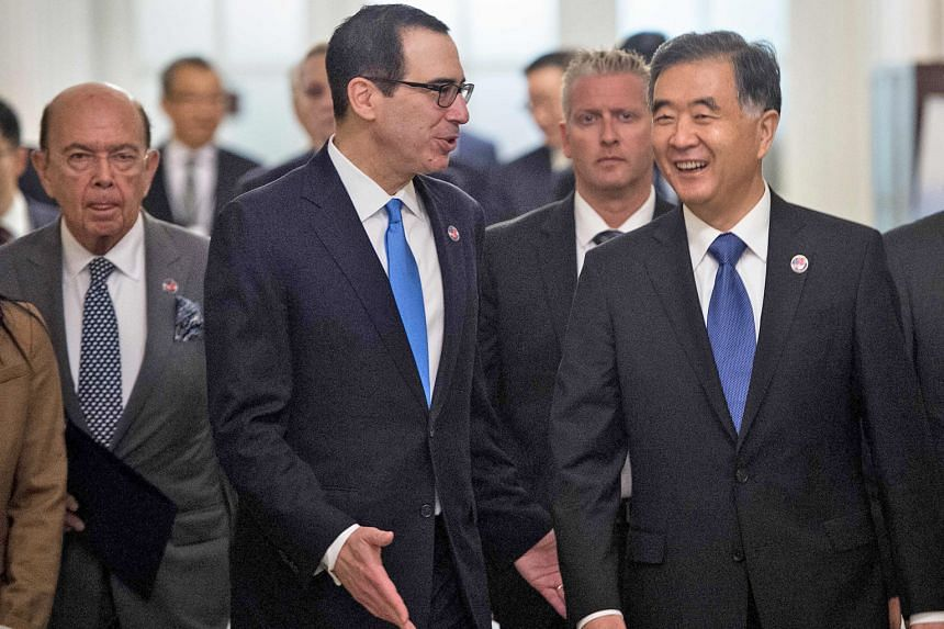 (From left) US Commerce Secretary Wilbur Ross, Treasury Secretary Steven Mnuchin and then Chinese Vice-Premier Wang Yang headed for a bilateral economic dialogue in Washington in July last year. China remains on the Treasury's currency watch list. Ch
