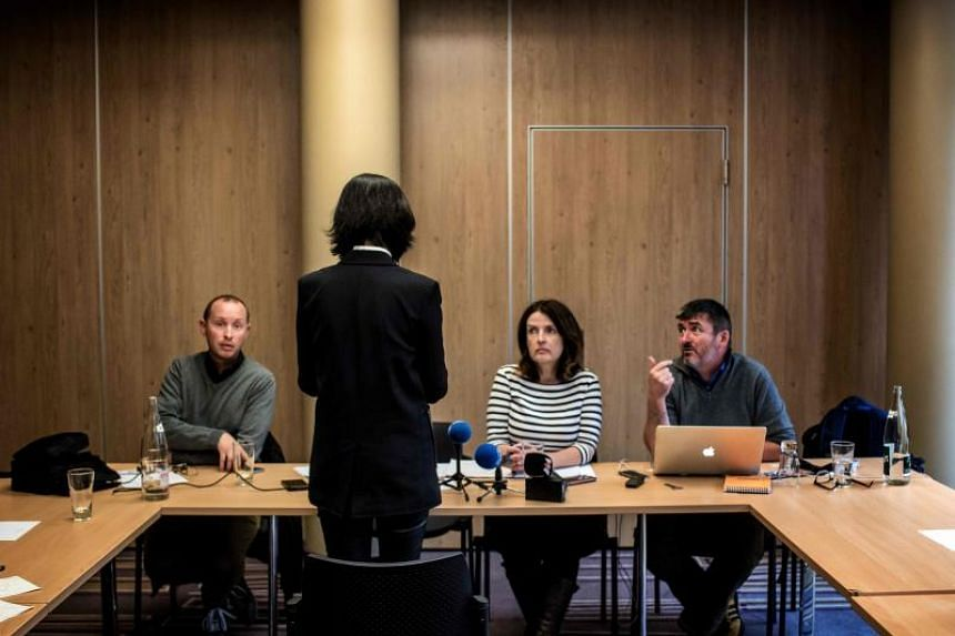 """Mrs Grace Meng (in black) speaking to journalists on Oct 7 in Lyon. She claimed to have received threatening phone calls suggesting she was being """"targeted"""" in France."""