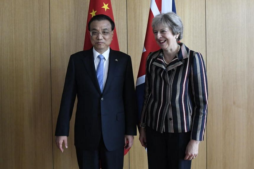 China's Prime Minister Li Keqiang (left) and Britain's Prime Minister Theresa May during a EU-Asia leaders summit in Brussels, Belgium, on Oct 19, 2018.