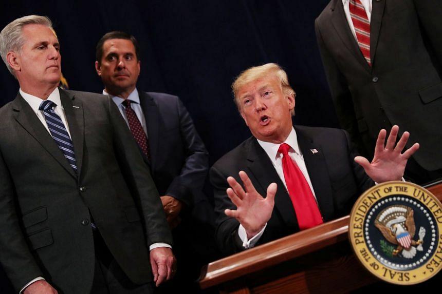 Trump (centre) speaking prior to signing a presidential memorandum in Scottsdale, Arizona.