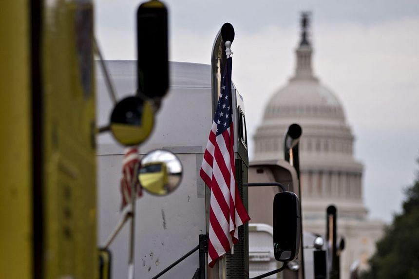 An American flag hangs on a long-haul truck parked near the US Capitol.