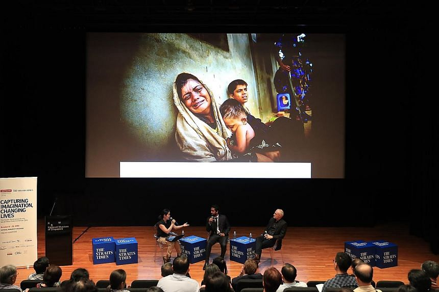 From left: Straits Times executive photojournalist Neo Xiaobin with Mr Masfiqur Sohan and Mr Patrick Brown at a panel discussion on conflict and refugee crises, at the National Museum of Singapore yesterday.