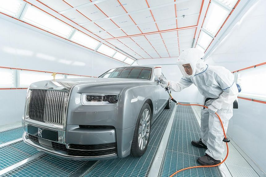 A Rolls-Royce limousine getting a paint touch-up in a dust-free paint booth at Eurokars' new $70 million integrated warehousing, servicing and car pre-delivery centre in Tanjong Penjuru, which will open next week.