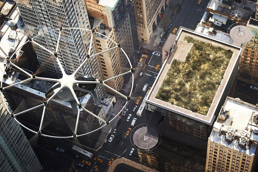 Artists' impressions of Volocopter's air taxis. The German aviation start-up is working with the Civil Aviation Authority of Singapore to establish the scope of the test flights. The air taxi looks like a helicopter but is based on drone technology.