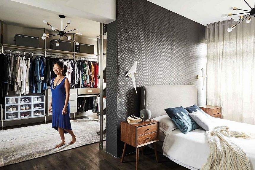 "(Left) A wallpaper with a triangular motif gives this ""lounge"" area, converted from a bedroom, a quirky touch. (Above) Eye-catching lamps add interest to the master bedroom and walk-in wardrobe. (Above and right) Accessories such as scarves and belts"