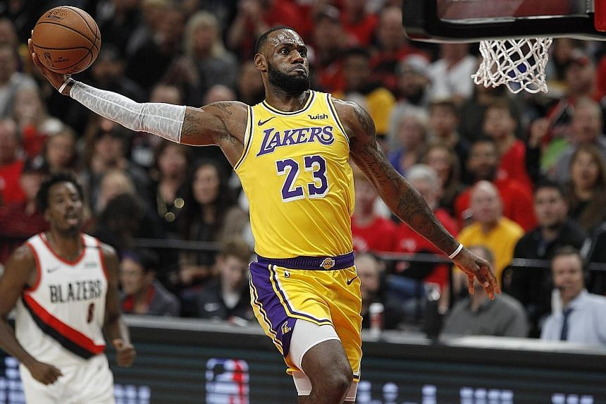 Los Angeles Lakers forward LeBron James soars to the hoop for a dunk against the Portland Trail Blazers in Thursday's 128-119 loss. The Lakers have lost to Portland 16 times in a row.