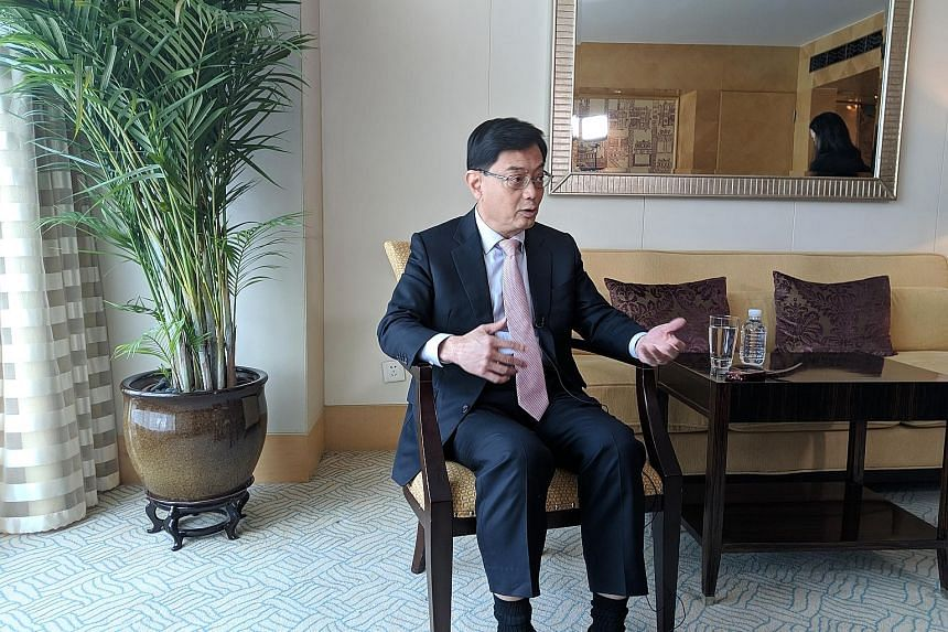 Finance Minister Heng Swee Keat said one way the world can do its part in finding a solution to the mounting US-China trade dispute is by studying how World Trade Organisation rules need to be changed to take into account the changing structure of th
