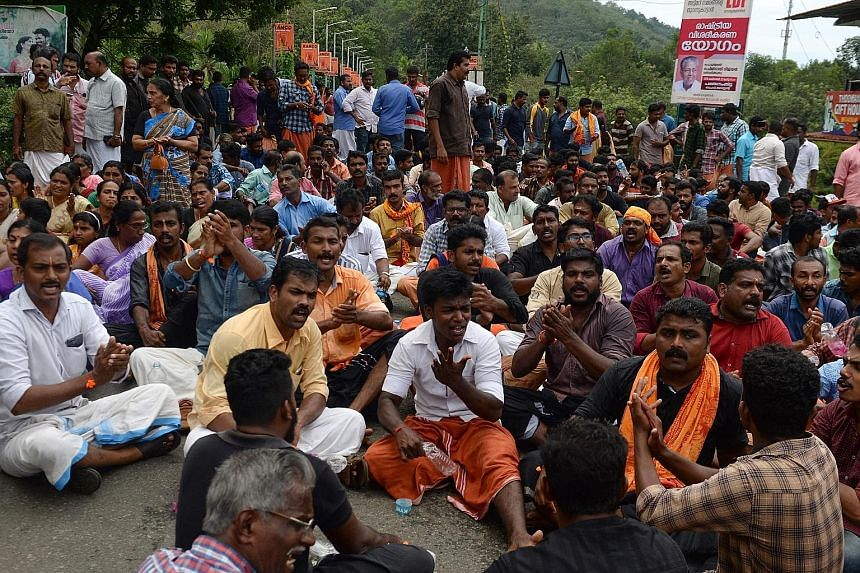 Protesters blocking a road to the Sabarimala temple in Kerala yesterday. Some clashed with police and attacked women.