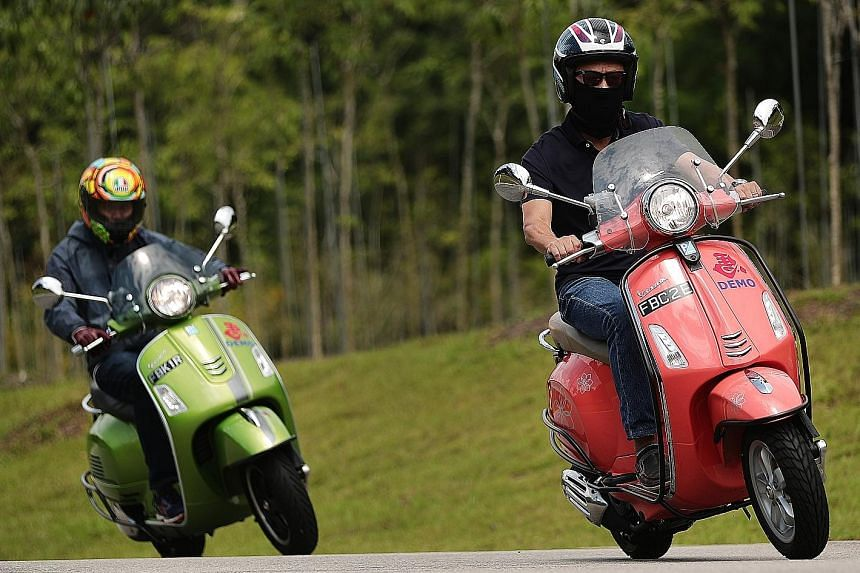 The Straits Times' Christopher Tan (right) leads on the 2018 Vespa Primavera 150, while colleague Zaihan Mohamed Yusof (left) catches up on the more powerful 2018 Vespa GTS Super 300. Both scooters are agile in bends, especially when dodging bumps on road