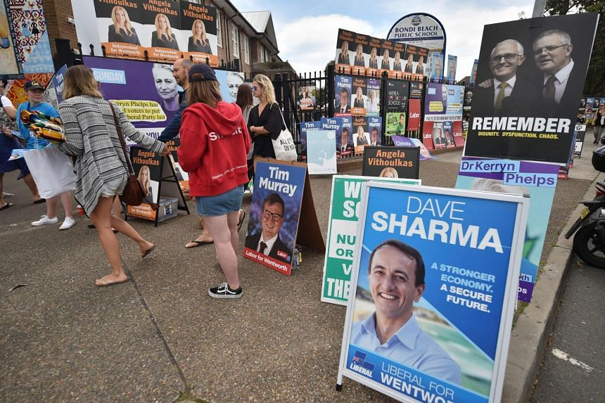 Election posters are seen outside a polling station during the Wentworth by-election in Bondi Beach in Sydney, on Oct 20, 2018.