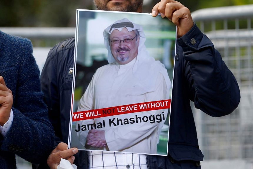 A demonstrator holds picture of Saudi journalist Jamal Khashoggi during a protest in front of Saudi Arabia's consulate in Istanbul, Turkey, on Oct 5, 2018.