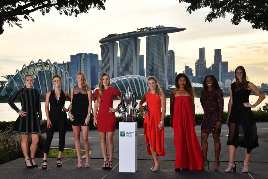(From left) Kiki Bertens, Elina Svitolina, Petra Kvitova, Caroline Wozniacki, Angelique Kerber, Naomi Osaka, Sloane Stephens, and Karolina Pliskova pose with the Billie Jean King Trophy at Gardens By The Bay East on Oct 19, 2018.