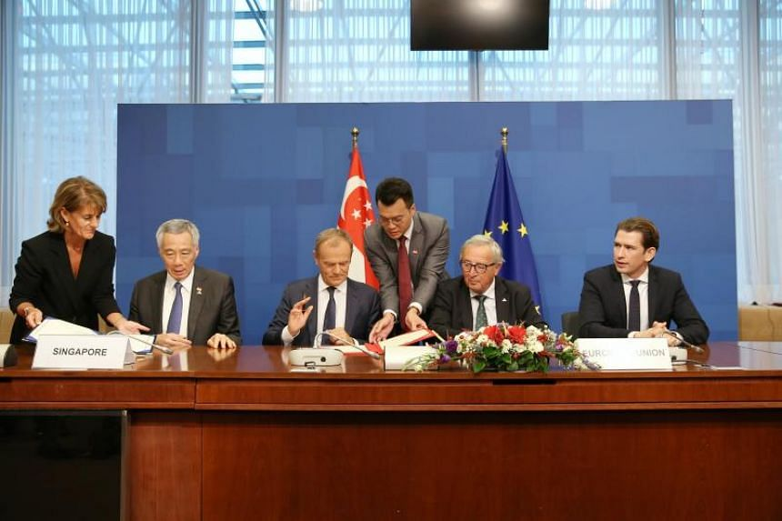Prime Minister Lee Hsien Loong (second from left) signing the EU-Singapore Free Trade Agreement with European Council President Donald Tusk, European Commission President Jean-Claude Juncker and Austrian Chancellor Sebastian Kurz on Oct 19, 2018.