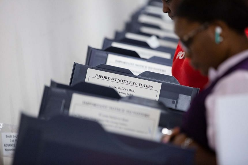 Early voting for the upcoming US midterm elections takes place in Atlanta, Oct 15, 2018.