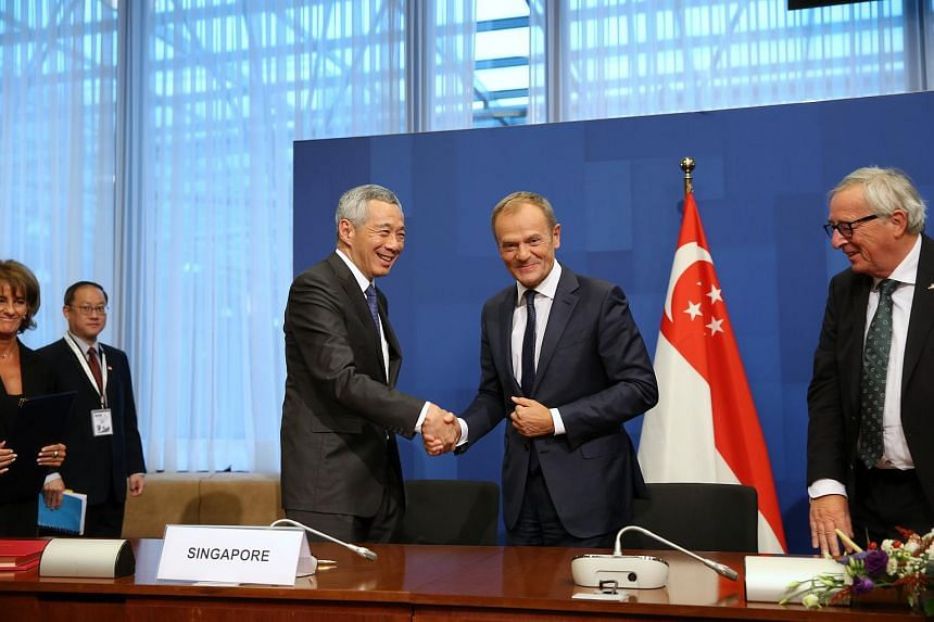 PM Lee and President of the European Council Donald Tusk shake hands as President of the European Commission Jean-Claude Juncker (right) looks on prior to the signing of the EU-Singapore Free Trade Agreement, on Oct 19, 2018.