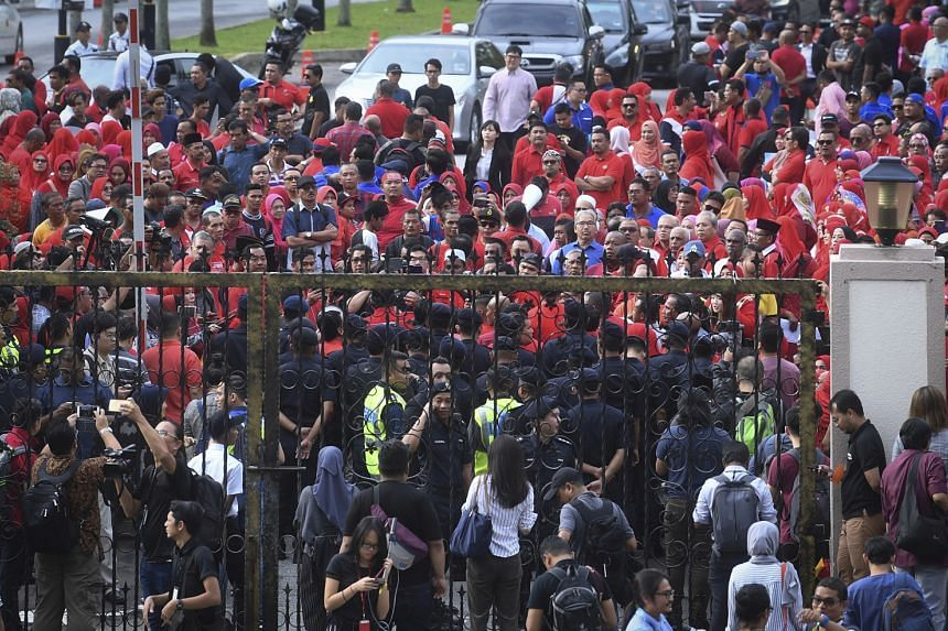Hundreds of Umno supporters dressed in red gathered at the entrance of the Kuala Lumpur Court Complex yesterday where former deputy prime minister Ahmad Zahid Hamidi was charged. Some of them carried banners that read: ''Stop political prosecution.''