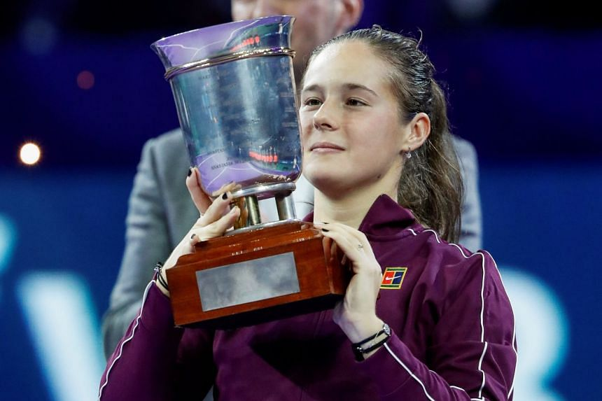 Kasatkina holds her trophy after defeating Ons Jabeur of Tunisia.