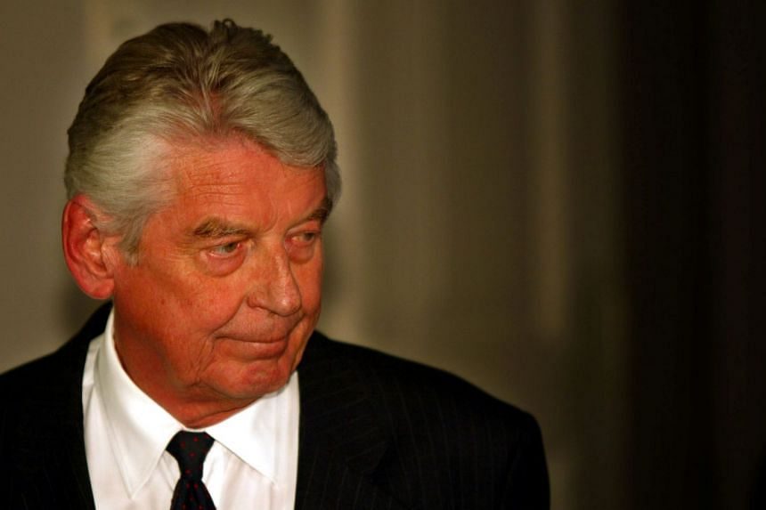 Kok's (above) time in power coincided with that of US President Bill Clinton and Britain's Tony Blair.