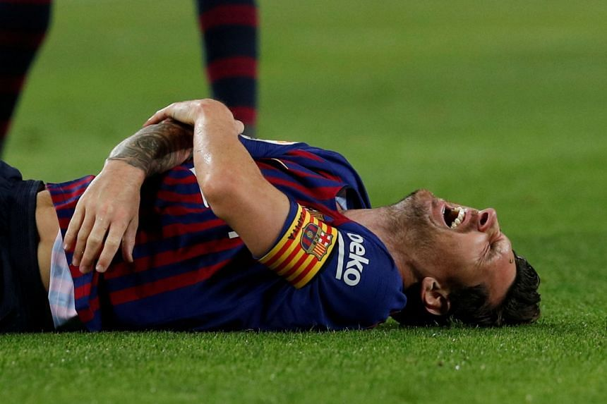 Barcelona's Lionel Messi after sustaining an injury.