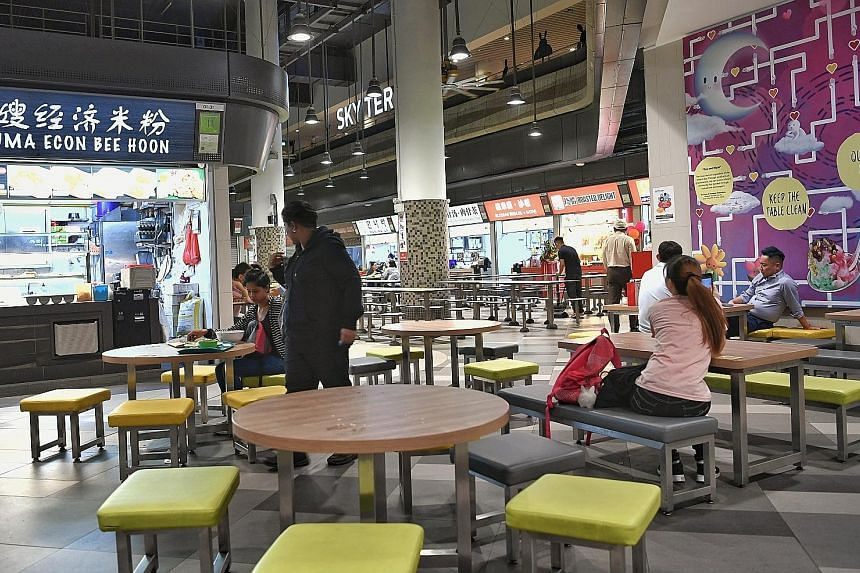 2.50amHawker centre workers resting in the quiet night. There are now 16 stalls open 24 hours a day out of 42, down from 36 in 2016. 2am Hawker Alex Hoong serving junior college student Tan Yun Wee a bowl of Korean ramen noodles. Mr Hoong's Korean fo