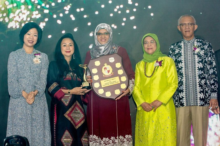 Ms Bibi Fatimah Sheikh Muhammad (centre), 55, was presented with the Exemplary Mother Award, which honours mothers from all walks of life who have made an impact on their family members and the community, from Muslim organisation Jamiyah Singapore ye
