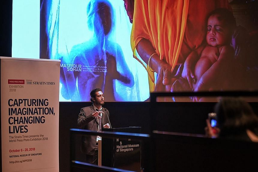 Award-winning Bangladeshi photojournalist Masfiqur Sohan talking yesterday about documenting the lives of people in Bangladesh, where he is based, at the World Press Photo Exhibition presented by The Straits Times. His talk and another by Australian