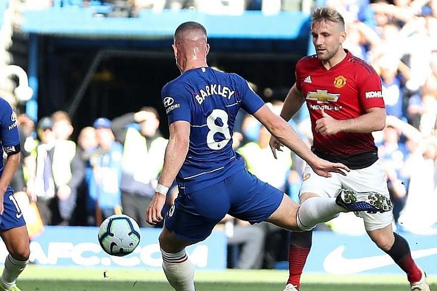 Ross Barkley making sure Chelsea remain unbeaten with his 96th-minute goal as Manchester United's Luke Shaw watches on.