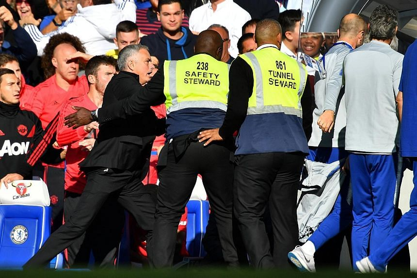 Manchester United manager Jose Mourinho rushes out of his seat after he was provoked by Chelsea assistant coach Marco Ianni following the Blues' last-gasp equaliser yesterday. The Premier League match ended 2-2.