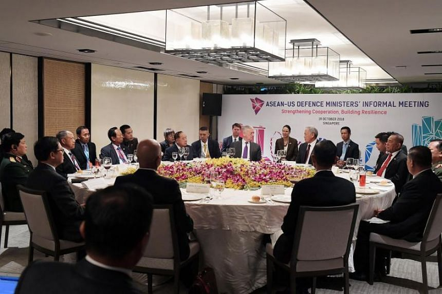 US Secretary for Defense James Mattis (centre, left) and Singapore Defence Minister Ng Eng Hen (centre, right) at the Asean-US Defence Ministers' Informal Meeting, on Oct 19, 2018.