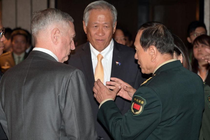 US Secretary for Defense James Mattis (left), and China's Minister of National Defense General Wei Fenghe (right) meet at a lunch hosted by Singapore Deputy Prime Minister Teo Chee Hean on Oct 20, 2018 at the Shangri-la Hotel Singapore.