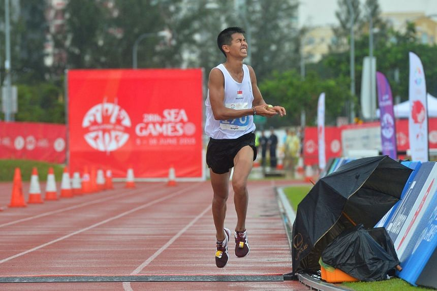 Ashley Liew Wei Yen reacts as he crosses the finishing line to place 8th in the Men's Marathon in the 28th SEA Games on June 7, 2015.