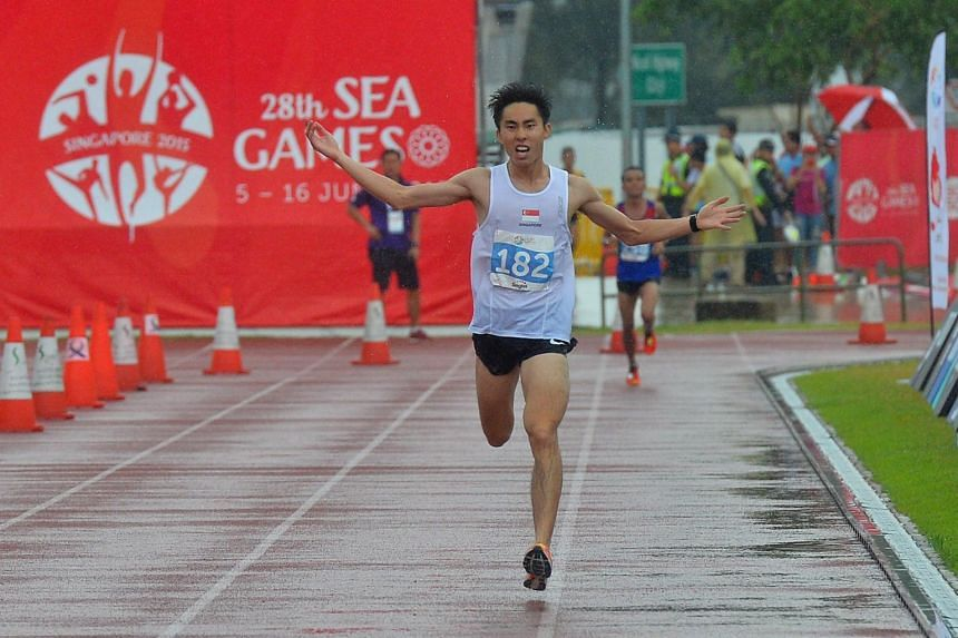 Soh Rui Yong celebrating as he approaches the finishing line to win the Men's Marathon in the 28th SEA Games on June 7, 2015.