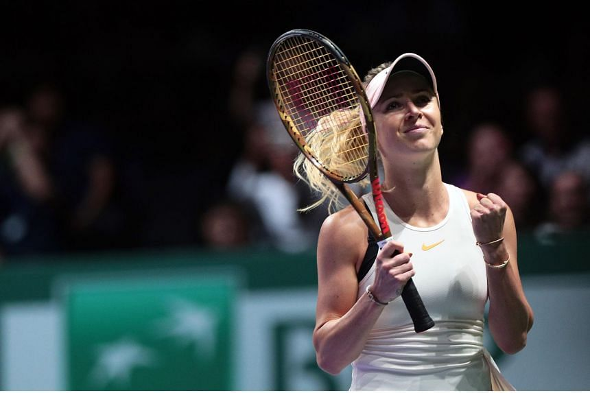 Elina Svitolina celebrates after winning her match against Petra Kvitova during their round robin singles match of the BNP Paribas WTA Finals 2018 at the Indoor Stadium on Oct 21, 2018.
