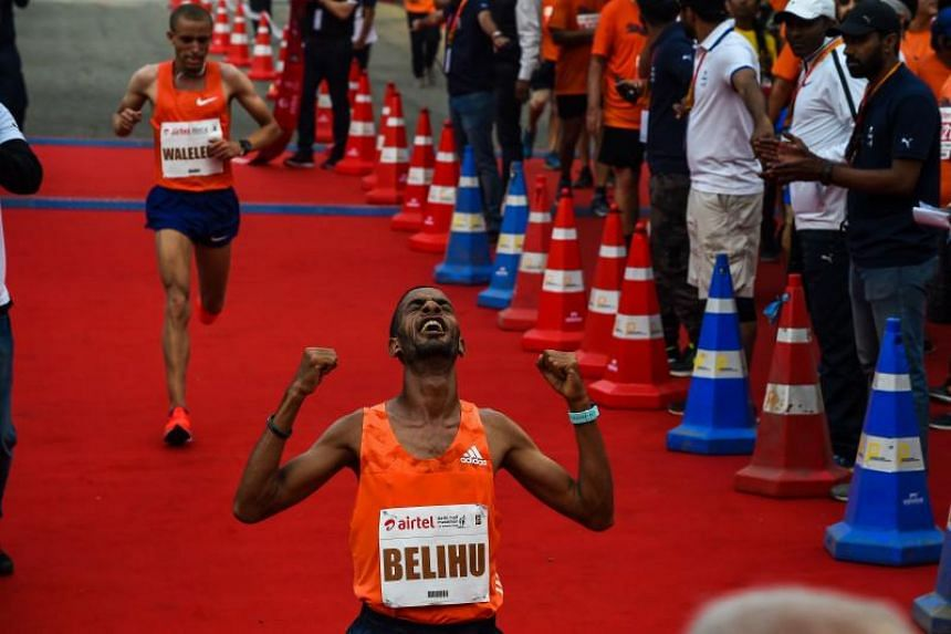 Ethiopian Andamalak Belihu finished first in the men's race in New Delhi on Sunday with a time of 59:18.