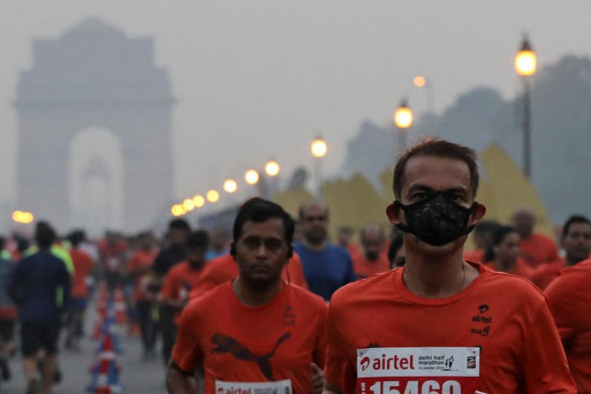 Although some participants at the half-marathon on Sunday wore masks, other runners said the air quality was no worse than the usual morning haze.