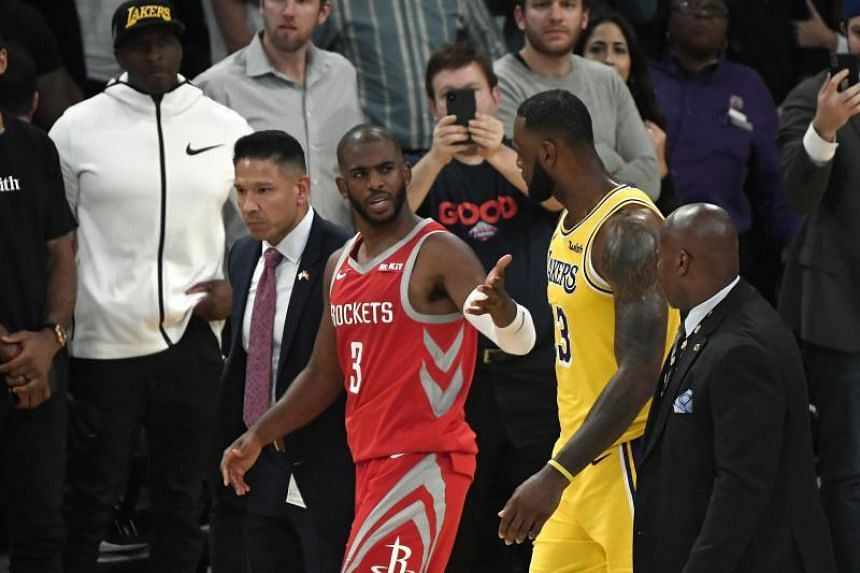 Houston Rockets' Chris Paul speaks to Los Angeles Lakers' LeBron James after he was ejected for fighting during their NBA match at Staples Center in Los Angeles on Oct 20, 2018.