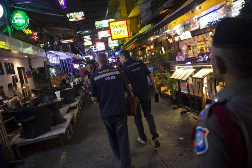 Police patrol Bangkok's Patpong district during a police operation called X-Ray Outlaw Foreigner on Oct 18, 2018.