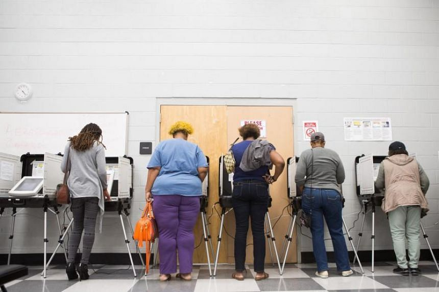 Voters cast ballots during the early voting period at C.T. Martin Natatorium and Recreation Center in Atlanta, Georgia, on Oct 18, 2018.