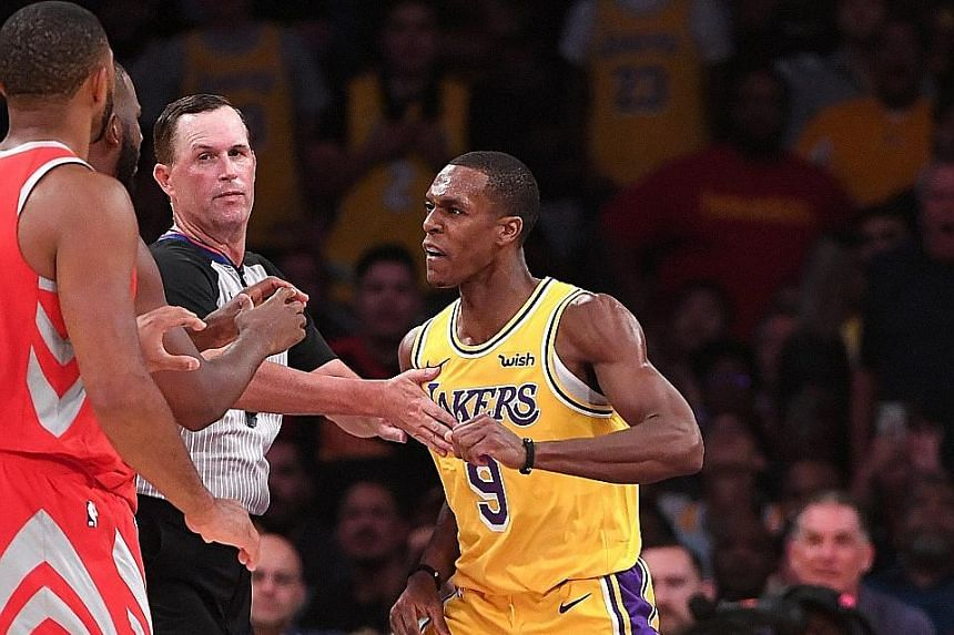 The Lakers' Rajon Rondo (right) and the Rockets' Chris Paul traded blows after Paul stuck his finger in Rondo's face.